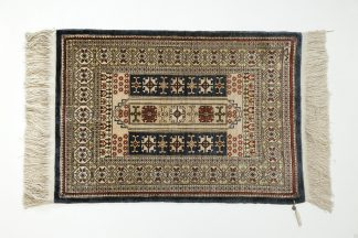 Small Hereke carpet