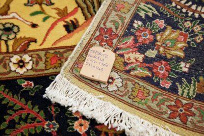 Yellow Tabriz carpet